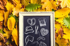 Oktoberfest symbols in picture frame, chalk drawings, autumn lea Stock Images