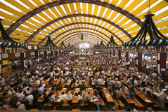 Oktoberfest Tent. Indoor picture of the Paulaner tent with people drinking and eating - Oktoberfest / Wiesn - beer fest - Munich, Germany 2009 stock image