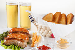 Oktoberfest traditional beer menu. Fried sausages with toast and mustard. Royalty Free Stock Image