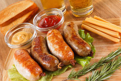 Oktoberfest traditional beer menu. Fried sausages with toast and mustard. Oktoberfest traditional beer food menu. Fried sausages with toast and mustard. Wooden royalty free stock photography