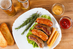 Oktoberfest traditional beer menu. Fried sausages with toast and mustard. Royalty Free Stock Photos