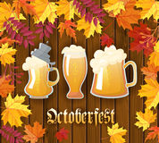 Oktoberfest .Traditional German autumn festival of beer background.Three mugs of beer on a wooden background with frame. Of autumn leaves. Cartoon flat style Royalty Free Stock Photos