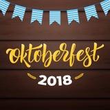Oktoberfest 2018. Trendy Oktoberfest lettering on wooden background Royalty Free Stock Photos