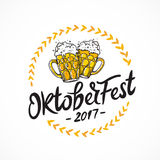 Oktoberfest 2017. Two mugs of beer. Oktoberfest 2017. Vector illustration on white background. German folk festivities. Lettering and calligraphy. Two mugs of Royalty Free Stock Photos