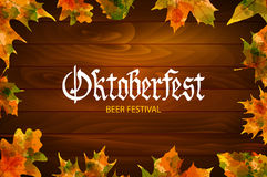 Oktoberfest vintage frame with beer and autumn leafs on the wood background . Poster template. Vector illustration, EPS 10. Stock Images