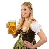 Oktoberfest waitress with beer. Photo of a beautiful female waitress wearing traditional dirndl and holding a huge beer over white background Royalty Free Stock Photos