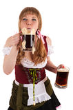 Oktoberfest woman blows with beer foam Stock Photos