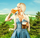 Oktoberfest woman drink froth beer from mug Stock Photo
