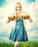 Oktoberfest woman with six beer mugs Royalty Free Stock Photography