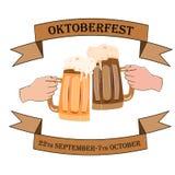 Oktoberfestconcept met het beeld van twee handen met bierbakas op een geïsoleerde achtergrond Royalty-vrije Stock Fotografie