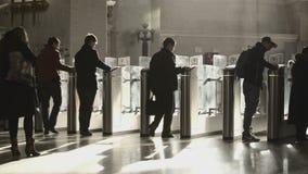 Oktyabrskaya metro station. MOSCOW, RUSSIA - APRIL 11, 2014: People walking through the stile at Oktyabrskaya metro station stock video footage