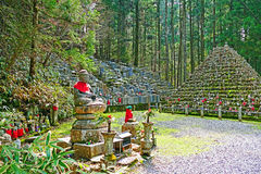Okunoin Cemetary at Koyasan. Mountains of Buddhist relics, replicas and statues at Okunoin Cemetary inside Mount Koya Stock Photo