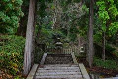 Okunoin Cemetery on Mt. Koya in Japan. An ancient tombstone at Okunoin Cemetery on Mt. Koya in Wakayama, Japan Stock Photography