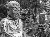Okunoin graveyard, Koya San, Japan. Okunoin graveyard with detail of Jizo statue, Koya San, Japan Royalty Free Stock Photos