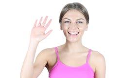 Olá!, olá!, mão de ondulação da mulher, fundo branco imagem de stock royalty free
