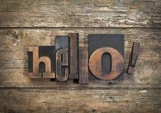 Olá!, palavra escrita com bloco de impressão da tipografia do vintage Imagens de Stock