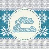 Olá! rotulação de dezembro no fundo feito malha do inverno Imagem de Stock Royalty Free