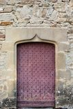 Ol reddish door on a stone wall stock photos