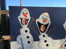 Olaf. Having fun in cut outs while looking for Christmas Stock Photography