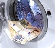Olagliga kontanta euro och pund för penningtvätt Arkivfoto