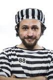 Olagligt desperat, stående av en manfånge i fängelseskrud, nolla fotografering för bildbyråer
