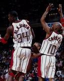 Olajuwon y Cassell, Houston Rockets Imagenes de archivo