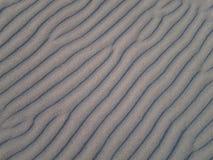 Olas oceánicas en la arena Fotografía de archivo libre de regalías