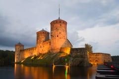 Olavinlinna castle in the august twilight. Savonlinna Stock Photo
