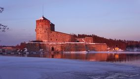 Olavinlinna fortress on march evening. Savonlinna, Finland. Olavinlinna fortress on march evening. Savonlinna. Finland stock video footage