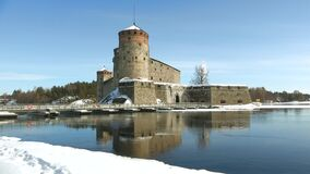 Olavinlinna fortress on a Sunny March day. Savonlinna, Finland. Olavinlinna fortress on a Sunny March day. Savonlinna. Finland stock video
