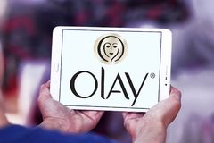 Olay logo. Logo of beauty and cosmetics company olay on samsung tablet stock photos