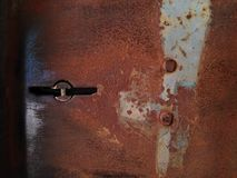 Old metal door. Old metal door closeup royalty free stock images