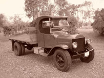 AN OLD 1920 ERA TRUCK. THIS IS AN OLDER 1920 ERA TRUCK, WITH DUEL TIRES IN THE REAR. THIS WAS SHOT IN SEPIA Stock Photo