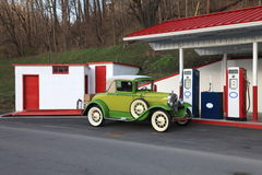Old 1930 car getting gas royalty free stock image