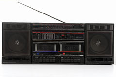 Old 1980 Stereo Boombox HiFi. Old black stereo boombox with antenna taken out, on white background royalty free stock image