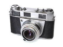 Old 35mm camera. Over white stock images
