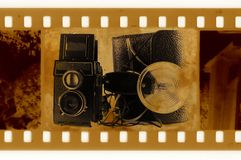 Old 35mm frame photo with camera. Old 35mm frame photo with photo camera and flash Royalty Free Stock Photos