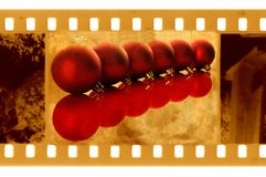 Old 35mm frame photo with christmas balls Stock Image