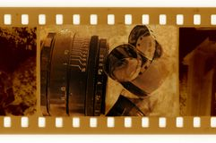 Old 35mm frame photo with film tape. And vintage glass Stock Photography