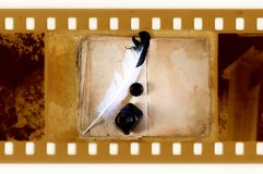Old 35mm frame photo with vintage book Royalty Free Stock Photography