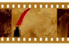 Old 35mm frame photo with vintage feather. Old 35mm frame photo with vintage  inkwell and red feather Royalty Free Stock Images