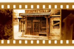 Old 35mm frame photo with vintage sheriff house Royalty Free Stock Photography