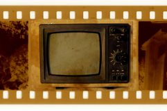 Old 35mm frame photo with vintage TV Royalty Free Stock Photo