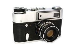 Old 35mm photo camera. Old 35mm film photo camera on white background Royalty Free Stock Photography