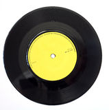 Old 45rpm record. A 1960s record, isolated on a white background. Details removed leaving space for copy Stock Photos