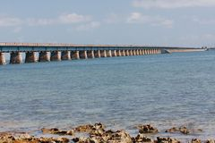 Old 7 Mile bridge at Water Lev. The railway antecedents of the old 7 Mile Bridge are clearly visible from water level Royalty Free Stock Images