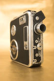 Old 8mm Film Camera. On gold background Royalty Free Stock Photos
