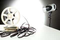 Old 8mm Video Tape And Studio Flashlight Royalty Free Stock Image
