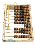 Old abacus, coins and shells isolated on white Royalty Free Stock Images