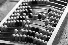 Old abacus lay on stone table. Close up black and white photo with selective focus Stock Photos